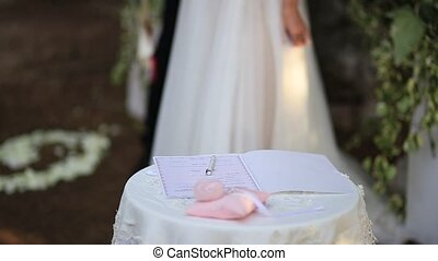 The bride puts the signature on wedding - The bride puts the...
