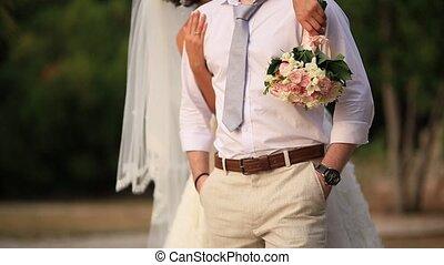 The bride is hugging the groom. Wedding Montenegro - The...