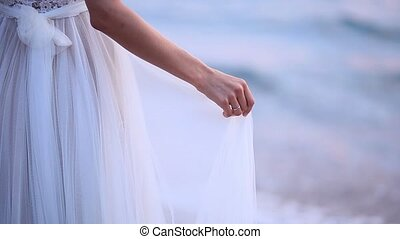 Touches the dress. The bride waving her dress. Fluttering...