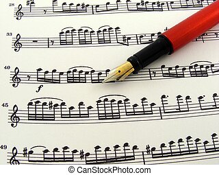 Sheet music with fountain pen3 - A sheet of music notes with...