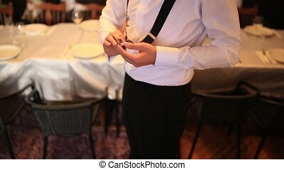 The man puts on a belt-suspenders for trousers. The wedding...