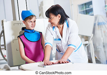 Nurse assistant with little boy preparing or x-ray radiography