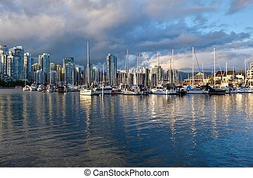 Vancouver skyline and reflection in the bay.