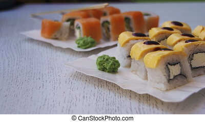 Fresh Sushi Rolls in a Restaurant on a Stylish White Wooden...