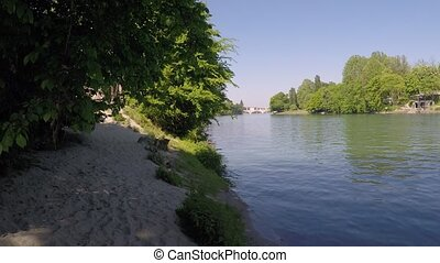 Pan over river and canoes or kayak moving - Horizontal pan...