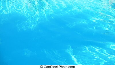 clear blue water in swimming pool in summer Sunny day -...