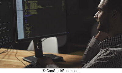 Positive freelance programmer talking on smart phone - Nice...
