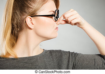 Girl pinches her nose because of stench stink. - Bad smell...