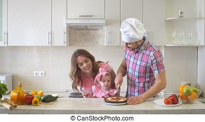 Happy Family In The Kitchen, Dad Cuts The Cake. - Happy...