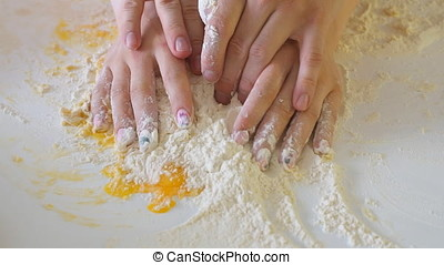 Young family knead the dough, close-up. - Young family knead...