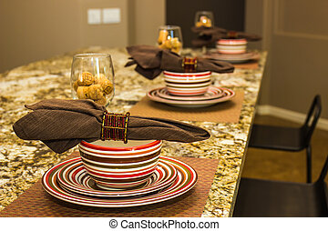 Place Settings For Guests On Granite Counter
