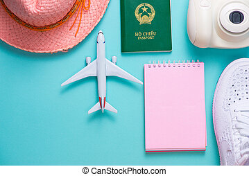 Vacation concept. Top view of travel accessories set on wooden background with copy space