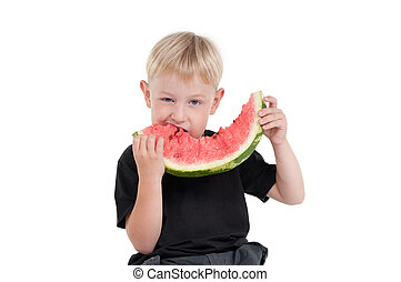 Boy eating a watermelon series 3 - Serious boy eating a...