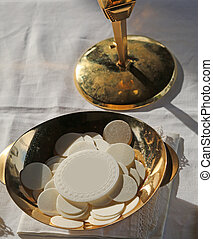 consecrated Host during the Mass of first communion - many...