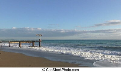 Beautiful seascape with tide and lonely pier - Beautiful...