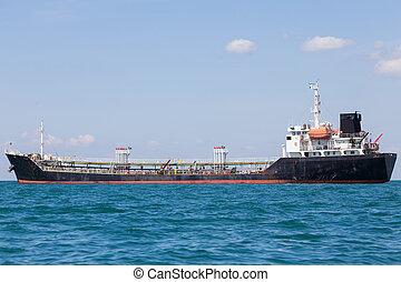 Oil transportation ship over ocean skyline