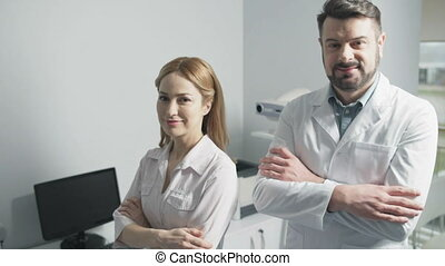Portrait of cheerful doctors posing together