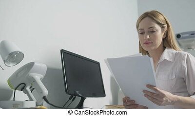 Agreeable female doctor looking at treatment results -...