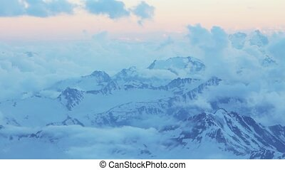 Snowy and deserted slopes of Mount Elbrus at sunset - Snowy...