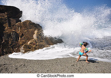 You or me? - Little girl fights big waves in Mediterannean...