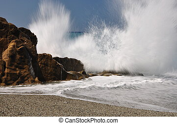 Big splash - Big waves hit rocks in Mediterannean Sea