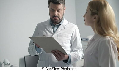 Portrait of two doctors having consultation - Doctors...