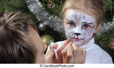 On girl painted on face - On face of little girl draw kitty....