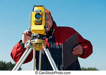 surveyor worker with theodolite outdoors