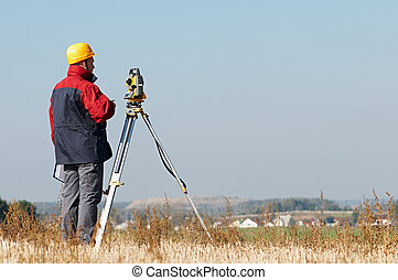 Geodesy. surveyor worker with theodolite outdoors