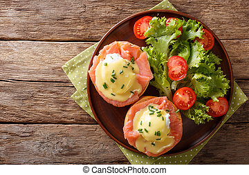 hearty breakfast: poached eggs with salmon and hollandaise...