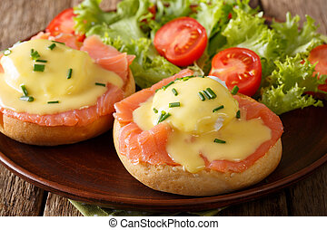 Eggs Benedict with salmon and hollandaise sauce close-up....