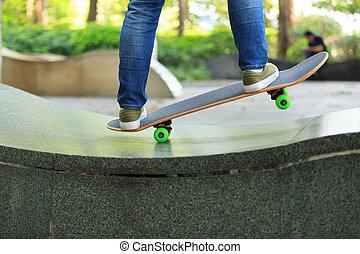 skateboarder legs skateboarding at skatepark