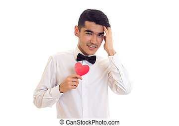 Young man holding a read heart - Confident young man with...