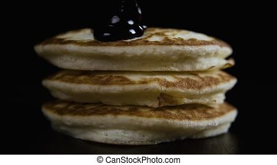 A pile of three pancakes with jam. Slow motion - A pile of...