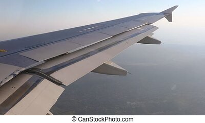 Flying on a plane - View from plane window during approach