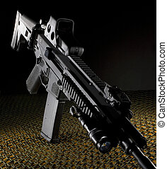 Assault rifle - assault rifle that is black on a dark...