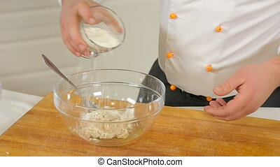 Making dough for curd pancakes - Chef is making cheese dough...