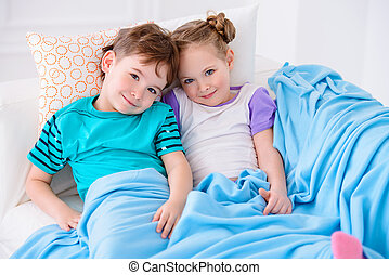 going to sleep - Two happy children playing together at...