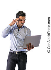 Young man working with computer standing