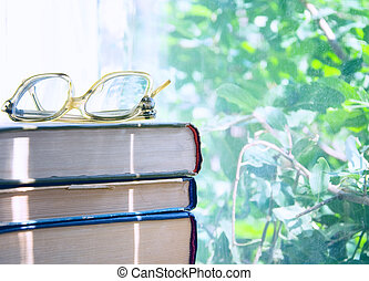 reading glasses lying on an books