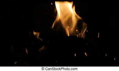 Fire in a small fireplace with a return thrust on a wooden...