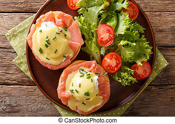 poached eggs with smoked salmon, hollandaise sauce and...