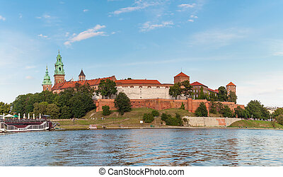 Wawel Castle from the Vistula River at sunset. Cracow,...