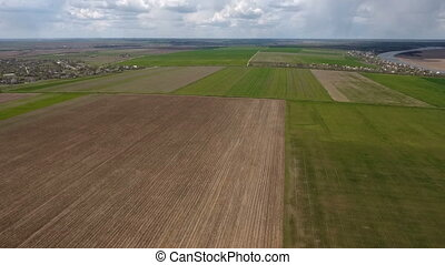 Aerial shot of the fertile humus fields near the Dnipro...