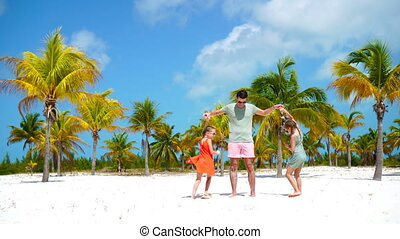 Happy family at tropical beach have fun. Father and little...