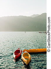 Kayaks moored in the water. Empty kayaks without people. In...