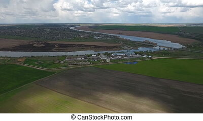 Aerial shot of a fabulous hook of the Dnipro with summer cottages on its bank