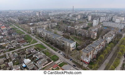 Aerial shot of Kherson city with its  multistoreyed buildings and highways