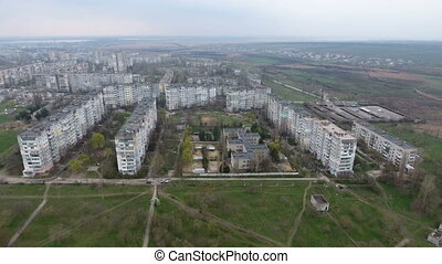 Aerial shot of Kherson city with its  multistoreyed buildings and city roads