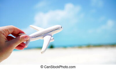 Small white miniature of an airplane toy on background of...